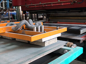 After 1,600 Tons Of Pressure Has Insured The Ingrediants Are Pressed Into The Shape Of The Form Uniformily, The Moist Formed hydroPAVERS® Are Vacuum Lifted To The Conveyer Line Leading To The Oven.